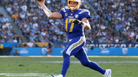 <p>               FILE - In this Sunday, Nov. 25, 2018, file photo, Los Angeles Chargers quarterback Philip Rivers (17) makes a scrambling pass attempt for a touchdown in the second half of an NFL football game in Carson, Calif. The almost 37-year-old Rivers connected on his first 25 passes to surpass Mark Brunell's mark of 22 in 2006, and finished 28 of 29 as during the Chargers routed the Cardinals 45-10 on Sunday (AP Photo/Peter Joneleit, File)             </p>