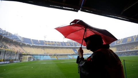 <p>               A journalist watches rain falling on the Alberto Armando stadium in Buenos Aires, Argentina Saturday, Nov. 10, 2018. The South American Football Confederation, CONMEBOL, postponed, due to heavy rain, the Copa Libertadores first leg semifinal soccer match between Boca Junior and River Plate. (AP Photo/Natacha Pisarenko)             </p>