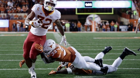 <p>               Iowa State running back David Montgomery (32) scores a touchdown past Texas linebacker Gary Johnson (33) during the second half of an NCAA college football game, Saturday, Nov. 17, 2018, in Austin, Texas. (AP Photo/Eric Gay)             </p>