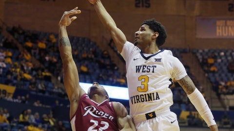 <p>               West Virginia guard James Bolden (3) tries to block a shot by Rider guard Kimar Williams (22) during the first half of an NCAA college basketball game Wednesday, Nov. 28, 2018, in Morgantown, W.Va. (AP Photo/Raymond Thompson)             </p>