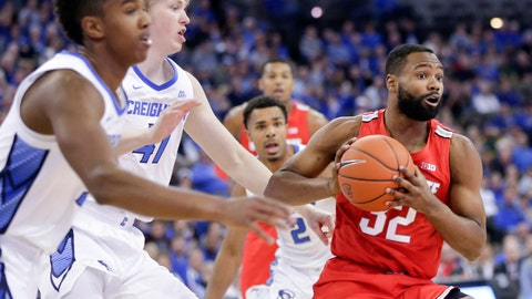 <p>               Ohio State's Keyshawn Woods (32) is guarded by Creighton's Ty-Shon Alexander, left, and Jacob Epperson (41) during the first half of an NCAA college basketball game in Omaha, Neb., Thursday, Nov. 15, 2018. (AP Photo/Nati Harnik)             </p>