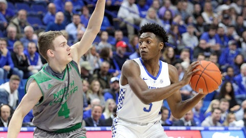 <p>               Kentucky's Immanuel Quickley, right, looks for a teammate while defended by North Dakota's Davids Atelbauers (4) during the first half of an NCAA college basketball game in Lexington, Ky., Wednesday, Nov. 14, 2018. (AP Photo/James Crisp)             </p>