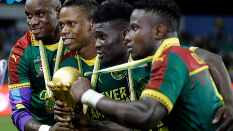 <p>               FILE - In this Feb. 5, 2017, file photo, Cameroon players pose with the trophy after winning the African Cup of Nations final soccer match against Egypt at the Stade de l'Amitie, in Libreville, Gabon. Cameroon was stripped of the right to host next year's African Cup of Nations soccer tournament on Friday, Nov. 30, 2018, with its preparations way behind schedule and a violent separatist rebellion in parts of the country making it a security risk.  (AP Photo/Sunday Alamba, FIle)             </p>
