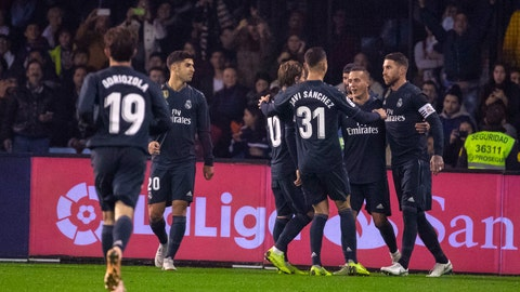 <p>               Real Madrid's Sergio Ramos, right, is congratulated by teammates after scoring a goal during a Spanish La Liga soccer match between RC Celta and Real Madrid at the Balaidos stadium in Vigo, Spain, Sunday, Nov. 11, 2018. (AP Photo/Lalo R. Villar)             </p>