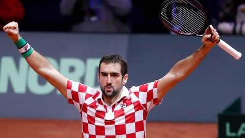 <p>               Croatia's Marin Cilic raises his arms after defeating France's Jo-Wilfried Tsonga during the Davis Cup final between France and Croatia, Friday, Nov. 23, 2018 in Lille, northern France. Croatia is within one point of a second Davis Cup title after Borna Coric and Marin Cilic dispatched their French rivals in the opening singles matches of the final to take a 2-0 lead. (AP Photo/Thibault Camus)             </p>