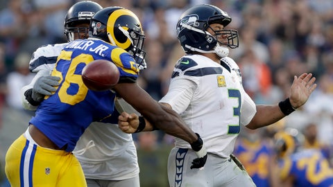 <p>               Los Angeles Rams defensive end Dante Fowler forces a fumble by Seattle Seahawks quarterback Russell Wilson during the second half in an NFL football game Sunday, Nov. 11, 2018, in Los Angeles.(AP Photo/Alex Gallardo)             </p>