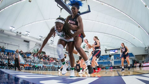 <p>               Notre Dame's Jackie Young, front left, and Gonzaga's Zykera Rice vie for the ball that went out of play during the first half of an NCAA women's college basketball game in Vancouver, on Thursday, Nov. 22, 2018. (Darryl Dyck/The Canadian Press via AP)             </p>
