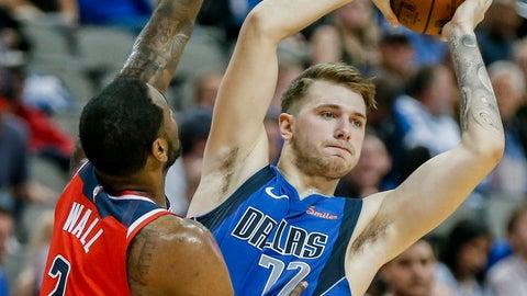 <p>               Dallas Mavericks forward Luka Doncic (77) looks for an open teammate as Washington Wizards guard John Wall (2) defends during the second half of an NBA basketball game, Tuesday, Nov. 6, 2018, in Dallas. Dallas won 119-100. (AP Photo/Brandon Wade)             </p>