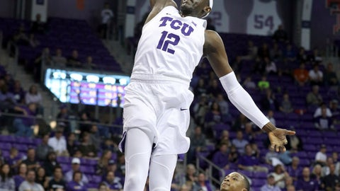 <p>               TCU forward Kouat Noi (12) goes up for a dunk against Central Michigan during the first half of an NCAA college basketball game Friday, Nov. 30, 2018, in Fort Worth, Texas. (AP Photo/Richard W. Rodriguez)             </p>