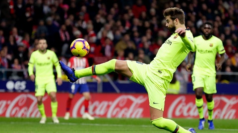 <p>               Barcelona's Gerard Pique kicks the ball during a Spanish La Liga soccer match between Atletico Madrid and FC Barcelona at the Metropolitano stadium in Madrid, Saturday, Nov. 24, 2018. (AP Photo/Manu Fernandez)             </p>