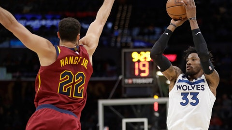 <p>               Minnesota Timberwolves' Robert Covington (33) shoots against Cleveland Cavaliers' Larry Nance Jr. (22) in the second half of an NBA basketball game, Monday, Nov. 26, 2018, in Cleveland. (AP Photo/Tony Dejak)             </p>