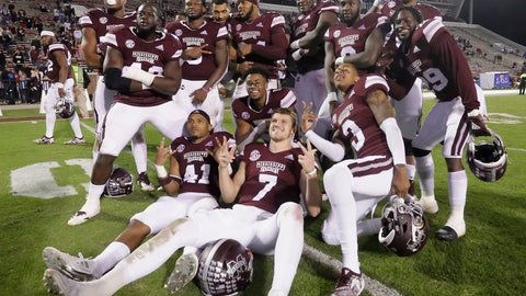 <p>               Mississippi State players including front row from left, Mark McLaurin (41), Nick Fitzgerald (7) and Cameron Dantzler (3), pose for a group photo after an NCAA college football game against Louisiana Tech, Saturday, Nov. 3, 2018, in Starkville, Miss. (AP Photo/Jim Lytle)             </p>