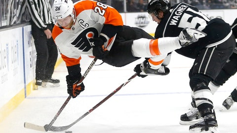 <p>               Philadelphia Flyers forward Claude Giroux (28) and Los Angeles Kings forward Austin Wagner (51) vie for the puck during the second period of an NHL hockey game Thursday, Nov. 1, 2018, in Los Angeles. (AP Photo/Ringo H.W. Chiu)             </p>