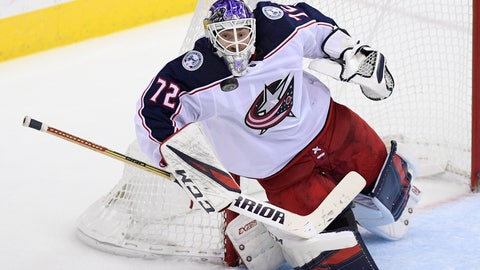 <p>               Columbus Blue Jackets goaltender Sergei Bobrovsky (72), of Russia, stops the puck during the third period of an NHL hockey game against the Washington Capitals, Friday, Nov. 9, 2018, in Washington. The Blue Jackets won 2-1. (AP Photo/Nick Wass)             </p>