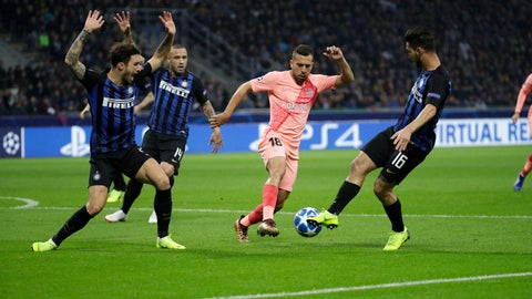 <p>               Barcelona defender Jordi Alba, second right, fights for the ball against Inter midfielder Matteo Politano, right, during the Champions League group B soccer match between Inter Milan and Barcelona at the San Siro stadium in Milan, Italy, Tuesday, Nov. 6, 2018. (AP Photo/Luca Bruno)             </p>