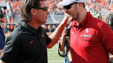 <p>               FILE - In this Saturday, Nov. 4, 2017, file photo, Oklahoma State head coach Mike Gundy, left, talks with Oklahoma head coach Lincoln Riley, right, before their NCAA college football game in Stillwater, Okla. While Oklahoma State has been erratic this season, and has been dominated in the rivalry series, the Cowboys have made it to overtime in two of their last three road games against Oklahoma. they won there in 2014, after an OT loss in 2012. (AP Photo/Sue Ogrocki, File)             </p>