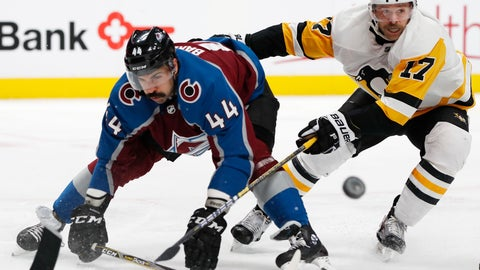 <p>               Colorado Avalanche defenseman Mark Barberio, left, is checked by Pittsburgh Penguins right wing Bryan Rust while they pursue a puck in the second period of an NHL hockey game Wednesday, Nov. 28, 2018, in Denver. (AP Photo/David Zalubowski)             </p>