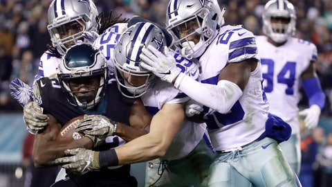 <p>               Philadelphia Eagles wide receiver Nelson Agholor, bottom left, is tackled by Dallas Cowboys middle linebacker Jaylon Smith, top left, outside linebacker Leighton Vander Esch, center, and free safety Xavier Woods during the second half of an NFL football game, Sunday, Nov. 11, 2018, in Philadelphia. (AP Photo/Matt Rourke)             </p>
