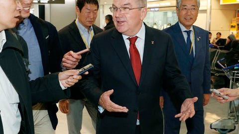 <p>               In this Nov. 23, 2018, photo, IOC President Thomas Bach, center, arrives at Narita Airport, near Tokyo. IOC President Bach and Japanese Prime Minister Shinzo Abe made a quick trip Saturday, Nov. 24, 2018, to the region northeast of Tokyo that was devastated by a 2011 earthquake and tsunami that destroyed three nuclear reactors. At right is Tsunekazu Takeda, an IOC member and head of the Japanese Olympic Committee. (Kyodo News via AP)             </p>