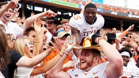 <p>               FILE - In this Oct. 6, 2018, file photo, Texas tight end Andrew Beck (47) wears the Golden Hat and celebrates with fans after defeating Oklahoma 48-45 in an NCAA college football game at the Cotton Bowl in Dallas. No. 5 Oklahoma and No. 9 Texas are playing in a rare Red River rivalry rematch in the Big 12 championship game on Saturday. It is the first time in 115 years that the border state rivals will play twice in the same season.  (AP Photo/Cooper Neill, File)             </p>