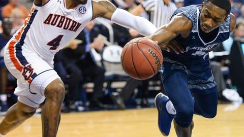 <p>               Auburn player Malik Dunbar (4) and Saint Peter's guard Dallas Watson (0) scramble for a rebound during the first half of an NCAA college basketball game, Wednesday, Nov. 28, 2018, in Auburn, Ala. (AP Photo/Julie Bennett)             </p>