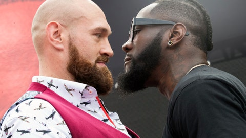 <p>               FILE  -  In this Oct. 2, 2018 file photo Tyson Fury, left, and Deontay Wilder face off during a news conference in New York ahead of their heavyweight world championship boxing match in Los Angeles on Dec. 1. Just how well Wilder's heavyweight title defense against Tyson Fury in Los Angeles will do at the box office on Saturday, Dec. 1, 2018 is a question mark. For all the power in his right hand, Wilder is still trying to build his brand and Fury is largely an enigma in the U.S. (AP Photo/Mary Altaffer, file)             </p>