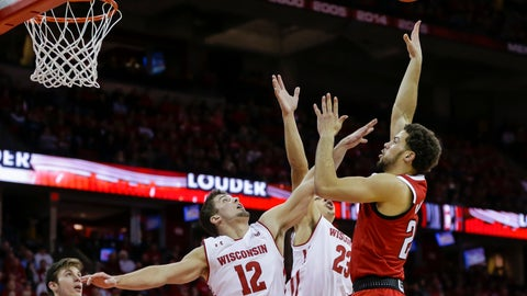 <p>               North Carolina State's Devon Daniels, right, shoots against Wisconsin's Trevor Anderson (12) and Kobe King (23) during the first half of an NCAA college basketball game Tuesday, Nov. 27, 2018, in Madison, Wis. (AP Photo/Andy Manis)             </p>