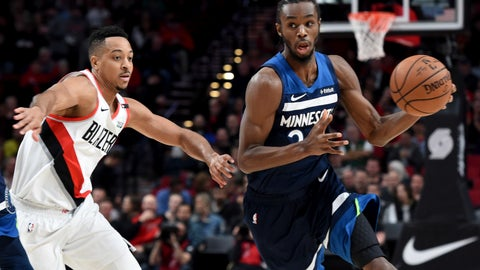 <p>               Minnesota Timberwolves forward Andrew Wiggins, right, tries to get past Portland Trail Blazers guard CJ McCollum, left, during the first quarter of an NBA basketball game in Portland, Ore., Sunday, Nov. 4, 2018. (AP Photo/Steve Dykes)             </p>