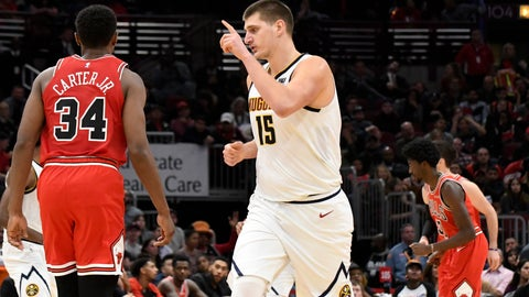 <p>               Denver Nuggets center Nikola Jokic (15) gestures after making a 3-point basket against the Chicago Bulls during overtime of an NBA basketball game Wednesday, Oct. 31, 2018, in Chicago. The Nuggets won 108-107. (AP Photo/David Banks)             </p>