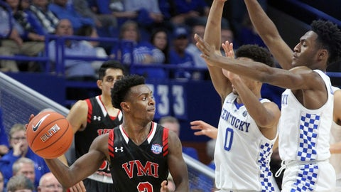 <p>               Virginia Military's Bubba Parham (3) passes around Kentucky defenders Quade Green (0) and Immanuel Quickley, right, during the second half of an NCAA college basketball game in Lexington, Ky., Sunday, Nov. 18, 2018. Kentucky won 92-82. (AP Photo/James Crisp)             </p>
