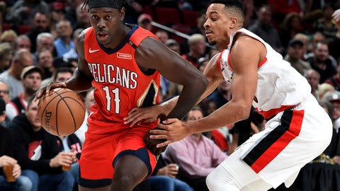 <p>               New Orleans Pelicans guard Jrue Holiday, left, drives to the basket on Portland Trail Blazers guard CJ McCollum during the first half of an NBA basketball game in Portland, Ore., Thursday, Nov. 1, 2018. (AP Photo/Steve Dykes)             </p>