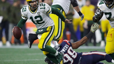 <p>               Green Bay Packers quarterback Aaron Rodgers (12) scrambles away from New England Patriots defensive end Trey Flowers (98) during the first half of an NFL football game, Sunday, Nov. 4, 2018, in Foxborough, Mass. (AP Photo/Charles Krupa)             </p>