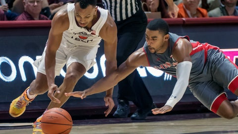 <p>               Virginia Tech guard Justin Robinson (5) (left) and Gardner-Webb guard Christian Turner (4) reach for the ball during the second half of an NCAA college basketball game Friday, Nov. 9, 2018, in Blacksburg, Va. Virginia Tech won 87-59. (AP Photo/Don Petersen)             </p>