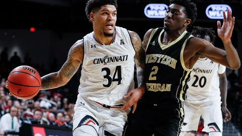<p>               Cincinnati's Jarron Cumberland (34) drives against Western Michigan Adrian Martin (2) during the first half of an NCAA college basketball game, Monday, Nov. 19, 2018, in Cincinnati. (AP Photo/John Minchillo)             </p>