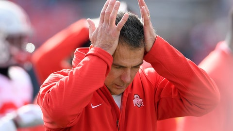 <p>               In this  Saturday, Nov. 17, 2018 photo, Ohio State head coach Urban Meyer holds his hands to his head before an NCAA football game against Maryland in College Park, Md. Urban Meyer doesn't seem to be having much fun these days. The Ohio State coach is not demonstrably mirthful, of course, at least not when it comes to his job. But the 54-year-old Meyer's sideline demeanor has taken on a decidedly beleaguered stoop this season. The usual shouting and gesticulating, the ripping off his headset, those are often followed by a hand moving up to the left side of his head because of severe headaches.(AP Photo/Nick Wass, File)             </p>