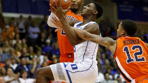 <p>               Auburn forward Anfernee McLemore (24) and guard J'Von McCormick (12) try to stop Duke forward RJ Barrett (5) from going to the basket during the first half of an NCAA college basketball game at the Maui Invitational, Tuesday, Nov. 20, 2018, in Lahaina, Hawaii. (AP Photo/Marco Garcia)             </p>