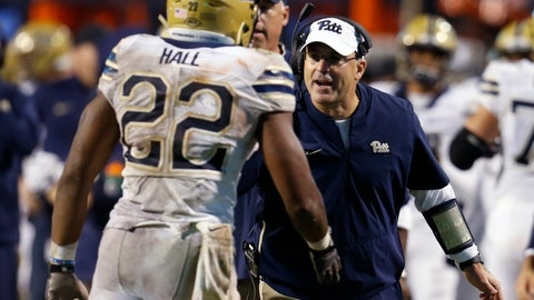 <p>               Pittsburgh coach Pat Narduzzi, right, welcomes running back Darrin Hall (22) back to the sideline after a touchdown during the second half of an NCAA college football game against Virginia in Charlottesville, Va., Friday, Nov. 2, 2018. (AP Photo/Steve Helber)             </p>
