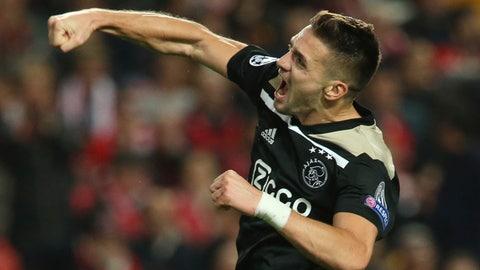 <p>               Ajax's Dusan Tadic celebrates scoring 1-1 during the Champions League group E soccer match between Benfica and Ajax at the Luz stadium in Lisbon, Wednesday, Nov. 7, 2018. (AP Photo/Armando Franca)             </p>