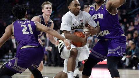 <p>               Wake Forest's Brandon Childress, center, drives between Western Carolina's Carlos Dotson, right, and Marcus Thomas, left, during the second half of an NCAA college basketball game in Winston-Salem, N.C., Tuesday, Nov. 27, 2018. (AP Photo/Chuck Burton)             </p>