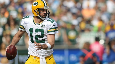 <p>               FILE - In this Oct. 28, 2018 file photo, Green Bay Packers quarterback Aaron Rodgers (12) looks for an open receiver downfield as he scrambles for more time in the second half of an NFL football game in Los Angeles. The Packers take on the New England Patriots on Sunday, Nov. 4.  (AP Photo/Peter Joneleit)             </p>