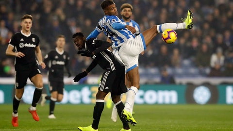 <p>               Huddersfield Town's Steve Mounie, center right, and Fulham's Andre-Frank Zambo Anguissa battle for the ball during their English Premier League soccer match at The John Smith's Stadium, Huddersfield, England, Monday, Nov. 5, 2018. (Martin Rickett/PA via AP)             </p>