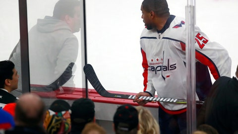 "<p>               FILE - In this Feb. 17, 2018, file photo, Washington Capitals right wing Devante Smith-Pelly (25) argues from the penalty box with Chicago Blackhawks fans during the third period of an NHL hockey game in Chicago. Washington Capitals forward heard the unmistakably racial taunts from fans from inside the penalty box. As a black hockey player, he knew exactly what they meant by yelling, ""Basketball, basketball, basketball."" (AP Photo/Jeff Haynes, File)             </p>"