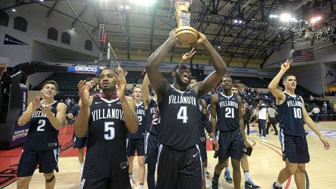 <p>               Villanova guard Phil Booth (5) celebrates with the championship trophy after getting a 66-60 win over Florida State in the championship game of an NCAA college basketball tournament Sunday, Nov. 25, 2018, in Lake Buena Vista, Fla. (AP Photo/Phelan M. Ebenhack)             </p>