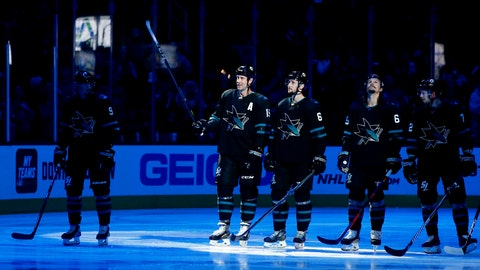 <p>               San Jose Sharks' Joe Thornton (19) is honored before the team's NHL hockey game against the Vancouver Canucks, for his 400th goal, 1,000th assist and 1,500th game, in San Jose, Calif., Friday, Nov. 23, 2018. With him are teammates Kevin Lebanc (62) and Erik Karlsson (65). (AP Photo/Josie Lepe)             </p>