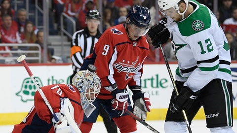 <p>               Dallas Stars center Radek Faksa (12), of the Czech Republic, fight for the puck against Washington Capitals goaltender Braden Holtby (70) and defenseman Dmitry Orlov (9), of Russia, during the first period of an NHL hockey game, Saturday, Nov. 3, 2018, in Washington. (AP Photo/Nick Wass)             </p>