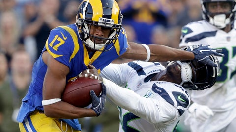 <p>               Los Angeles Rams wide receiver Robert Woods, left, pushes away Seattle Seahawks defensive back Delano Hill during the second half in an NFL football game Sunday, Nov. 11, 2018, in Los Angeles. (AP Photo/Alex Gallardo)             </p>