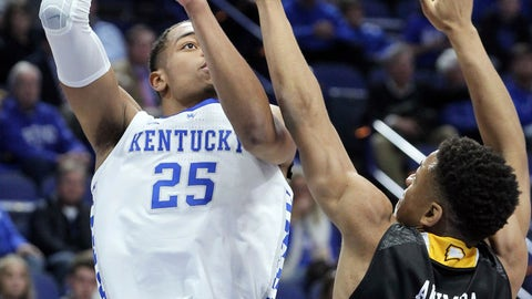 <p>               Kentucky's PJ Washington (25) shoots while defended by Winthrop's Micheal Anumba (3) during the first half of an NCAA college basketball game in Lexington, Ky., Wednesday, Nov. 21, 2018. (AP Photo/James Crisp)             </p>