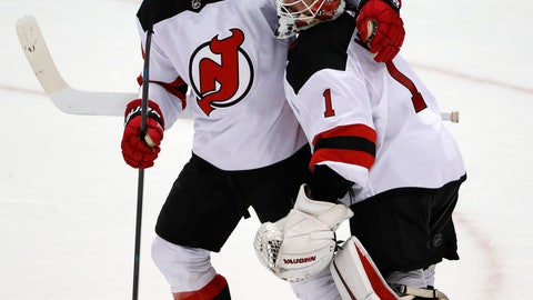 <p>               New Jersey Devils goaltender Keith Kinkaid (1) celebrates with Brian Boyle (11), who had a hat trick in an NHL hockey game against the Pittsburgh Penguins in Pittsburgh, Monday, Nov. 5, 2018. The Devils won 5-0. (AP Photo/Gene J. Puskar)             </p>