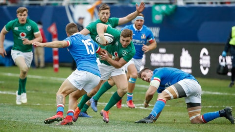 <p>               Ireland's Jordan Larmour, center, goes past Italy's Luca Sperandio, left, during the second half of rugby match Saturday, Nov. 3, 2018, in Chicago. (AP Photo/Kamil Krzaczynski)             </p>