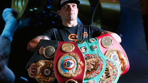 <p>               FILE - In this Wednesday, Aug. 1, 2018 file photo, Oleksandr Usyk presents his WBA, IBF, WBO and IBO belts trophies after a press conference in Kiev, Ukraine. Usyk is the undisputed Cruiserweight champion and picked up the first ever Muhammad Ali trophy in the World Boxing Super Series Final. The Ukrainian fighter makes the first defense of his four cruiserweight titles when he takes on Tony Bellew in Manchester on Saturday, Nov. 10, 2018. (AP Photo/Efrem Lukatsky, File)             </p>